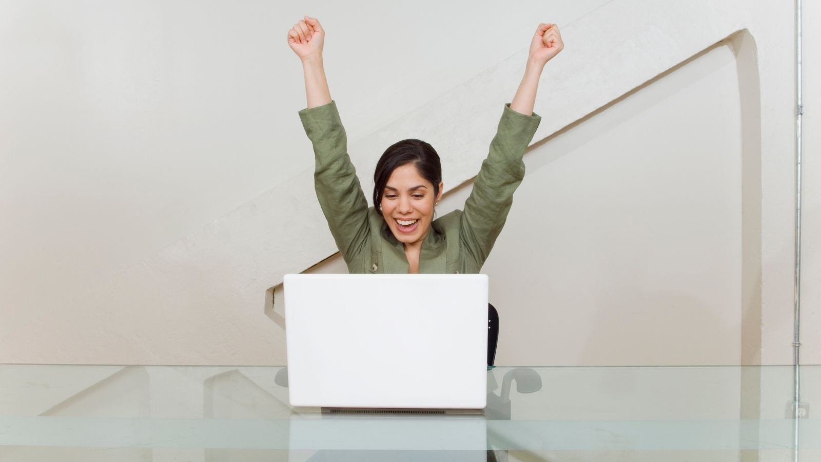 Woman who is excited about getting qualified through the RefiNow program offered by Fannie Mae.