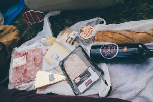 Wine, cheese, and cold cuts in front of the Eiffel Tower