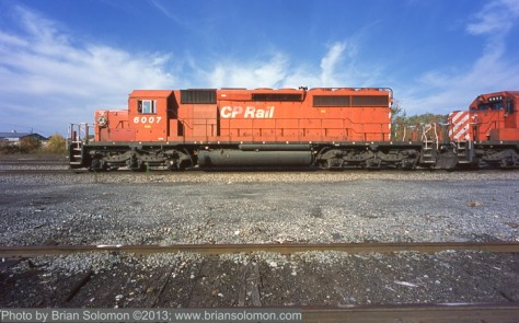 Broad side view of Canadian Pacific SD40-2 6007 at Bevier Street Yard in Binghamton, New York. Exposed with a Contax G2 rangefinder with 16mm Hologon lens. (This is a flat field design to obviate  barrel distortion).