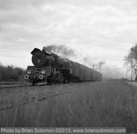 Regularly scheduled revenue steam-powered passenger train in rural Poland in April 2002.