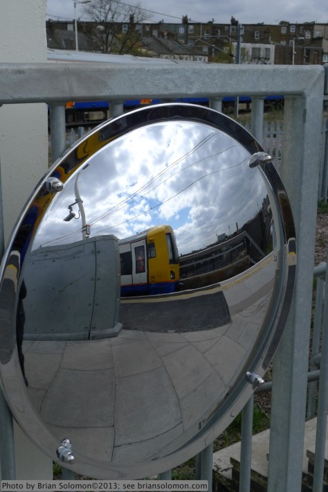 Mirror-view of London Overground.
