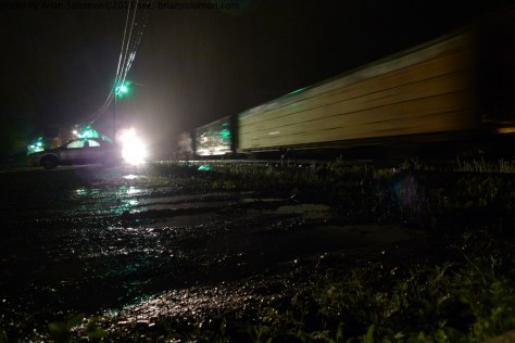 Rain at Palmer yard. May 24, 2013. New England Central freight . Lumix LX3 ISO 200 set at f2.5 1/1.6 seconds.