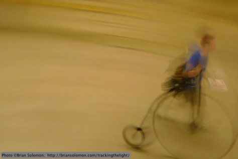 The ghost of an early twentieth century bicycle enthusiast crosses Grand Central's  concourse. Lumix LX3.
