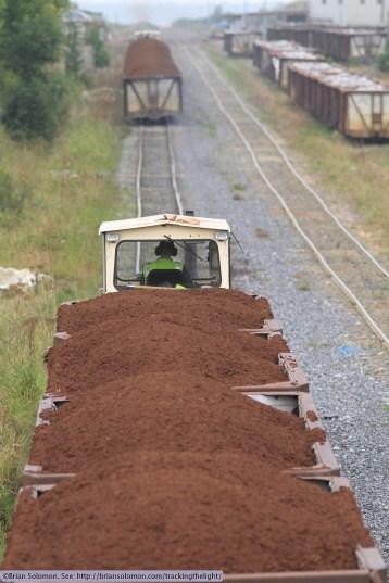 Laden trains approach Shannonbridge. Canon EOS 7D photo with f2.8 200mm lens.