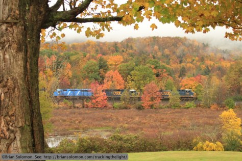 CSX L022 rolls west near Edwards Park, New York. Exposed at ISO 640 with a Canon EOS 7 with 28-135mm lens set at 53mm f5.6 at 1/200th second. To accentuate the autumn foliage, I manually set the white balance for a warmer setting rather than use the auto white balance that I find to be too cool for autumn trees.