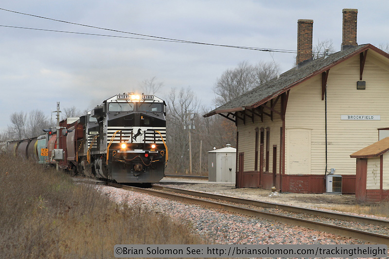 Freight passes the old Brookfield Station.