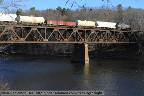 Maine Central 507 leads a short eastward freight across the Connecticut River.