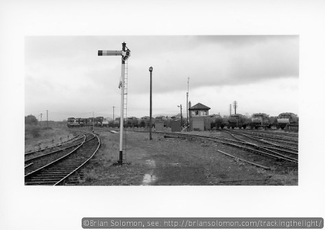 Here a pair of Class 121s leads the 10:34 Waterford-Limerick empty cement across the 'square crossing' at Limerick Junction. In America, we'd probably call this the 'Diamond at Limerick Junction'. Although this image was exposed as a square, I cropped the negative in printing to better focus on the railway infrastructure. The top third or so of the original negative just show clouds.