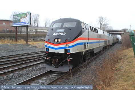 Amtrak has painted P42 145 in its 1970s-era scheme. It sits at CP83 in the driving rain waiting for a southward New England Central freight to clear the diamond on January 14, 2014. Canon EOS 7D with 20mm lens.