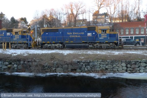 New England Central's GP38s lead a southward freight through downtown Stafford Springs, Connecticut on January 9, 2014.