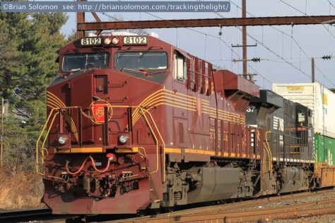 Norfolk Southern 8102 was in clean tuscan-red paint at it trailed at the back of nearly two-miles of double stacked containers. Canon EOS 7D with 100 mm lens.