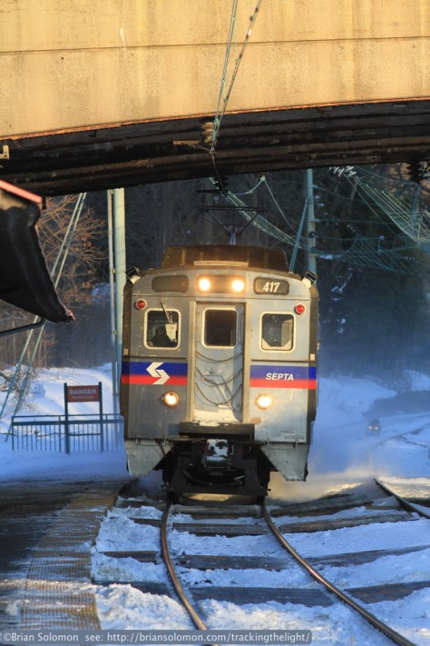 An eastbound SEPTA multiple unit passes Overbrook, Pennsylvania before 8am on January 23, 2014. Canon EOS 7D with 200mm lens.
