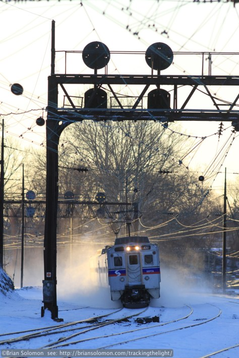 An outbound SEPTA multiple unit catches the glint of the rising sun at Overbrook, Pennsylvania before 8am on January 23, 2014.