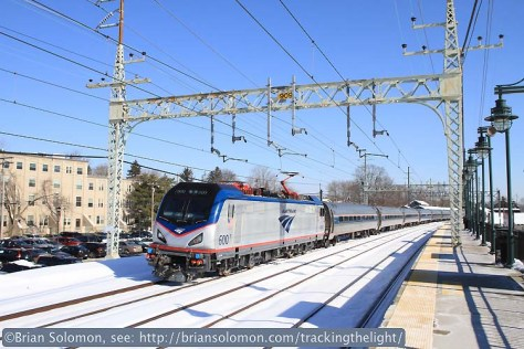 Brand new Amtrak electric 600 leads train 171 (Boston to Washington) at Milford, Connecticut at 10:56am February 7, 2014.  Canon 7D with 20mm lens. f4.5 1/2000th second, ISO 200.