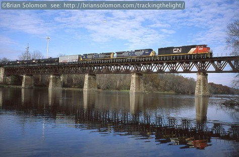 Canadian National unit ethanol symbol U70491-06 crosses the former Illinois Central Fox River Bridge at South Elgin on November 7, 2013. Exposed on Provia 100F with a Leica M4 and 35mm Summicron lens. Exposure calculated with a Minolta IV handheld light meter. Slide scanned with an Epson V600 scanner. This is a low-res conversion from the large Tiff scan.