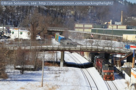 Pan Am Railway's EDPO (East Deerfield to Portland) eases downgrade in downtown Fitchburg. Our vantage point from the top of the parking garage at the railway station offered a superb place to make photos. Canon EOS 7D with 100mm lens.