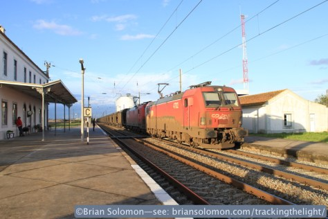 A double-headed empty coal train blitzes the station at Riachos T Novas, Golega bound for the port of Sines, south of Lisbon. Canon EOS 7D with 20mm lens.