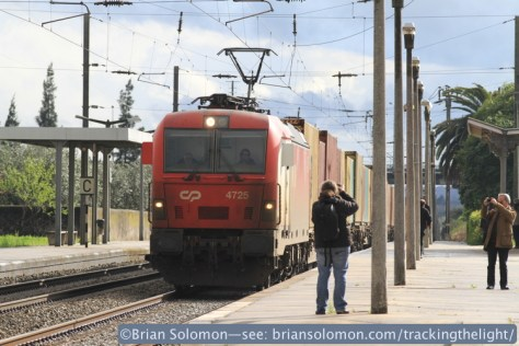 A camera club was snapping all angles at the station at Riachos T Novas, Golega. The passing CP container train was just one of their many subjects. Exposed with Canon EOS 7D with 200 mm.