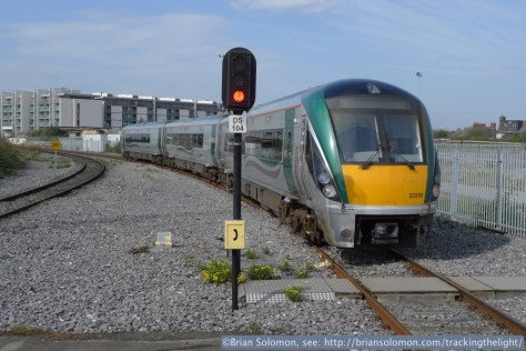 An Irish Rail four-piece InterCity Railcar arrives at Dublin's Docklands station on the afternoon of April 16, 2014. Lumix LX3 photo.