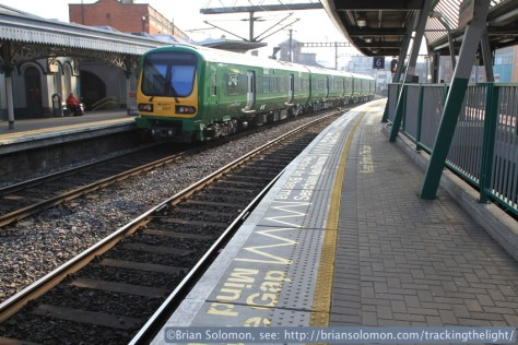 Irish Rail 0129117 in the new livery at Connolly Station on April 21, 2014. Canon EOS 7D with 20mm lens.