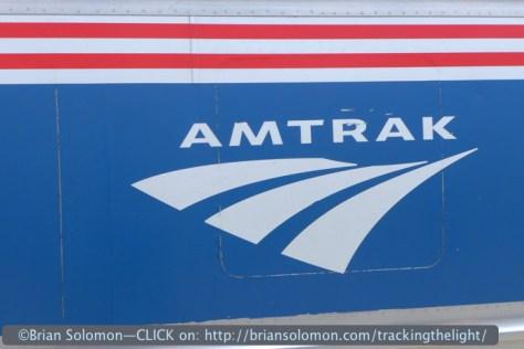 Amtrak logo on the side of an Amfleet car. Lumix LX-7 photo.