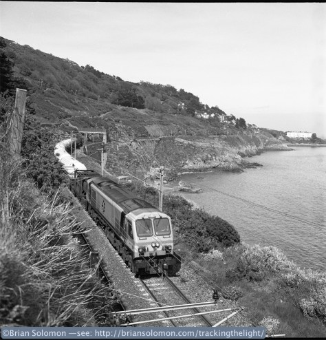 Irish Rail class 201 number 204 leads a laden Ammonia train above the Irish Sea at Killiney. Is that U2's Bono waving off in the distance? Exposed on Kodak Tri-X with a Rolleiflex Model T f3.5 Tessar lens, processed in Ilford ID11 (special mix and time,  1:1 with water.)