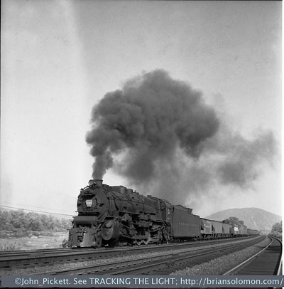 PRR's four-track Middle Division (Harrisburg to Altoona, Pennsylvania) was a favorite for photographers because of its accessibility, splendid scenery and a continuous parade of freight and passenger trains. PRR's big boiler M1 Mountains were a standard mainline freight power from the mid-1920s until the diesels took over. The M1 shared the boiler used by the I1s 2-10-0 'Hippo', where the I1s was intended for slow-speed drag freight work, the M1 was designed for relatively fast mainline running. These were good looking locomotives and made for great photos. Photo by John E. Pickett
