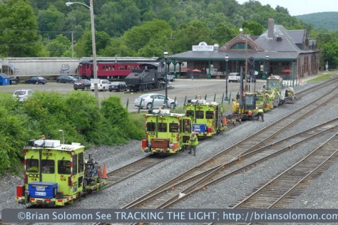 On June 11, 2014. A CSX tie gang works the old Boston & Albany route. In the distance is the popular Steaming Tender railroad themed-restuarant.