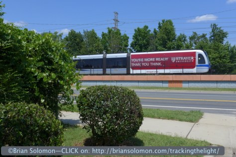 Some of the light rail cars carry advertising.