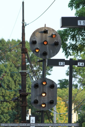 A vintage PRR position light signal (designed by A.H. Rudd) displays 'Approach Medium'. This signal is controlled by Overbrook tower, one of several classic interlocking towers on the Main Line in suburban Philadelphia. Canon EOS 7D with 200mm lens.