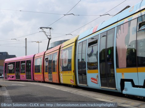 This trailing view made from a low angle is my favorite of the group of images because it best shows the various colour sections with minimal distractions. About this time my phone rang while the tram got the light to proceeed.