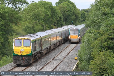 The Cork-Dublin Mark4 works toward Dublin with a 201-class diesel locomotive at the back. This meets an ICR working downroad. Canon EOS 7D photo.