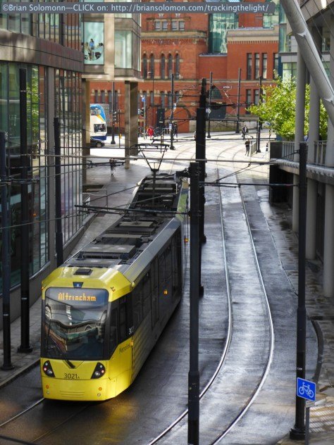 A bit of glint graces the back of an outbound tram near Manchester Piccadilly Station.