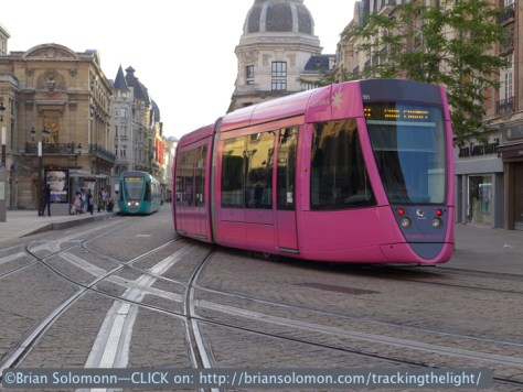 Trams pass in Reims. Lumix LX7 photo.