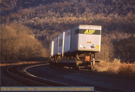 Piggyback trailers roll toward the Tuscarora Mountain on their eastward journey along the Juniata River Valley.