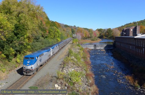 Amtrak 449 The Lake Shore Limited rolls west along the Quaboag River at West Warren, Massachusetts on the afternoon of October 12, 2014. Exposed with a Lumix LX7.