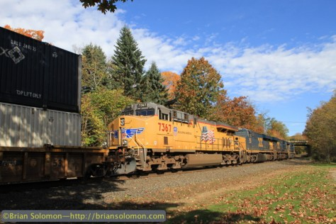 This last intermodal train had the added bonus of a Union Pacific GE in the consist. Canon EOS 7D with 20mm lens at Warren, Massachusetts.