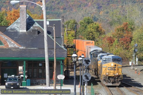 The first of the four eastward intermodal trains I photographed on Monday October 20th. CSX symbol Q020 rolls by the old Palmer Union Station (now Steamling Tender restaurant) at 11:16 am. On a normal day, I'd expect just one late morning intermodal train. Canon EOS 7D with 200mm lens.