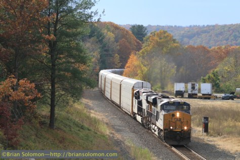 CSX Q264, the loaded eastward autorack train destined for the East Brookfield & Spencer at East Brookfield passes milepost 75 in West Warren. Canon EOS7D with 100mm lens.