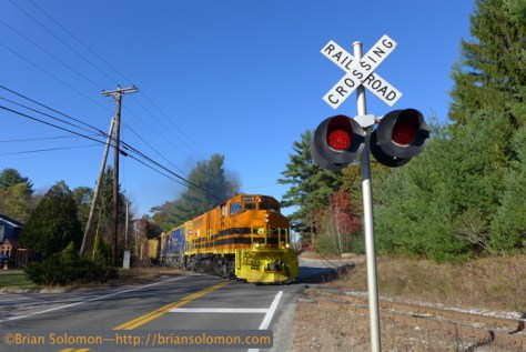New England Central 3015 leads job 610 across Route 32 at South Monson. Lumix LX7 photo.