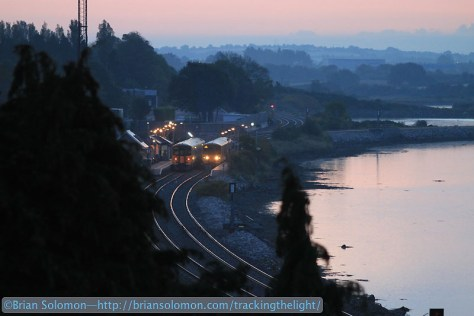 A few minutes before sunrise, Irish Rail 2600-series railcars pass at Glounthaune, Cork. At this hour the light changes quickly. Thankfully with modern digital cameras it is easy to adjust the ISO setting.