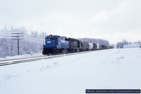 An hour after I let TV-302 go, I found a westward Delaware & Hudson freight crawling along at restricted speed. I learned later that snow had knocked some of the code lines down and the signals were displaying 'stop and proceed'. This image was made east of Owego, New York at 10:53 am on November 19, 1986. Kodachrome 25 slide flim.
