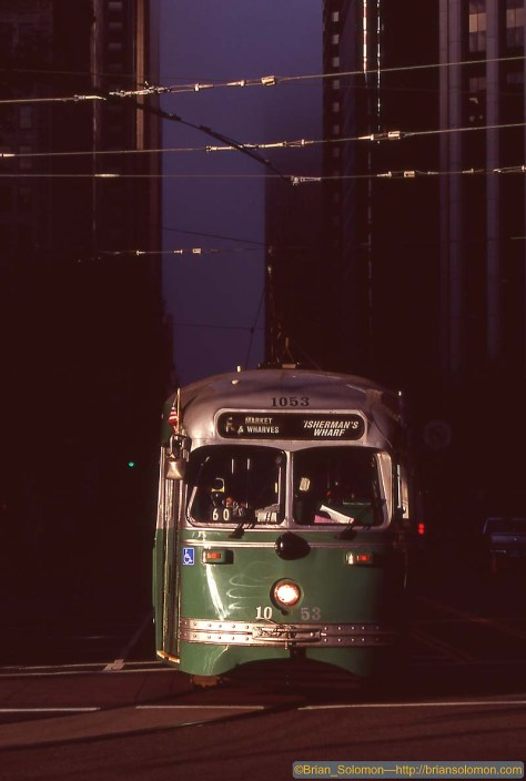 Cosmic light: an F-line PCC at the foot of Market Street with dense fog flowing over Twin Peaks. Exposed on Fujichrome using a Canon EOS 7D with 200mm lens.