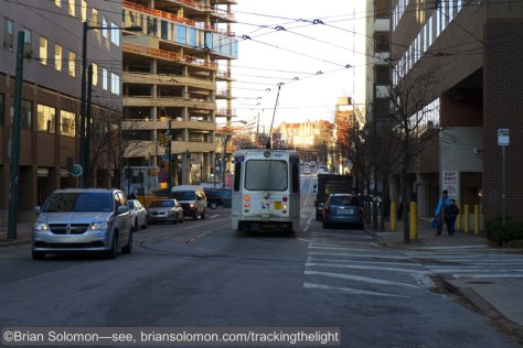 On the evening of December 15, 2014, a SEPTA streetcar turns the corner onto 36th Street. Lumix LX7 photo.