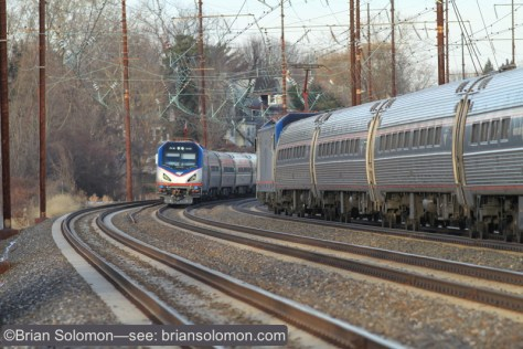 Just three minutes after the rolling meet between SEPTA trains on the outside tracks, we witnessed this high-speed meet between Amtrak trains on the inside tracks. Canon EOS 7D with 200mm lens. ISO 400.