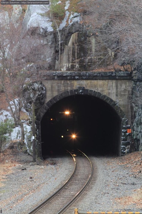 Not far behind the first northward freight was this train, seen about to exit the Fort Montgomery Tunnel. I'm standing in the same place as I had been for the last photo but opted for a longer lens. Exposed using a Canon EOS 7D with 200mm lens.