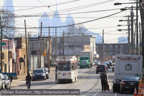 A SEPTA Kowasaki car works Lancaster Avenue with the Philadelphia Center City skyline in the distance. Canon EOS 7D with 200mm lens.