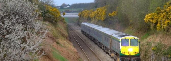 Irish Rail 215 and a Wink of Sun at Rathduff, County Cork.