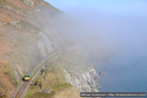 A DART electric skirts the cliffs at Bray Head. Fuji XT-1.