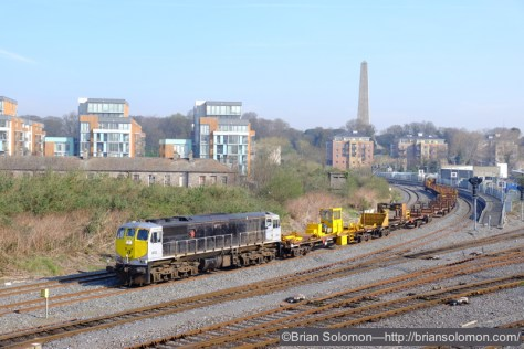 Venerable Irish Rail 072 (an old General Motors diesel electric with many miles on it) leads the empty LWR (long welded rail train) at Islandbridge Junction near Heuston Station in Dublin.